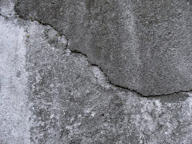 Repairing cracks in concrete