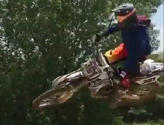Blake jumps with his motocross bike