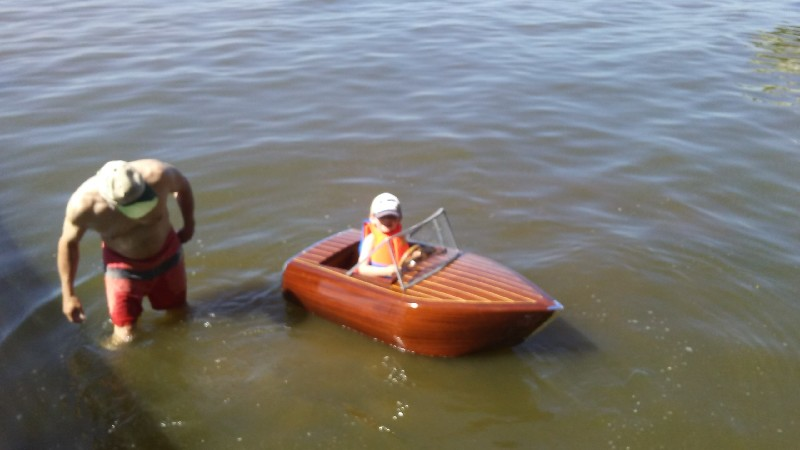 Daniel's grandson happily floating in his custom, pedal powered runabout.