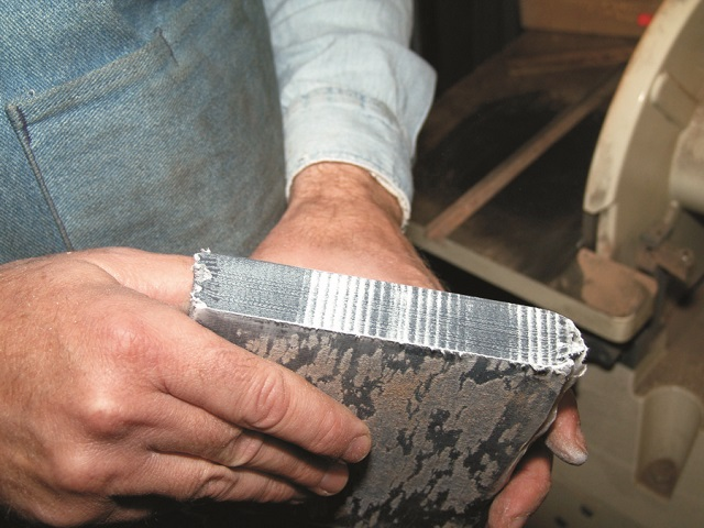 Tightly packed denim in wax paper for knife handle construction