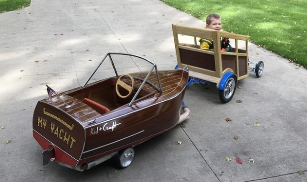 Daniel's grandson taking his new car and boat with trailer for a spin.