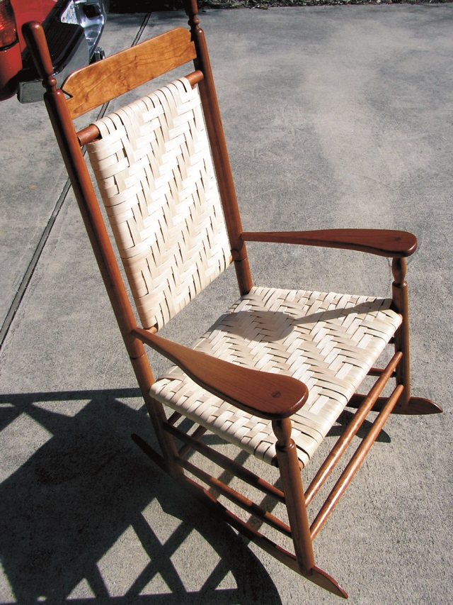 This cherry rocking chair is a piece of handcrafted furniture
