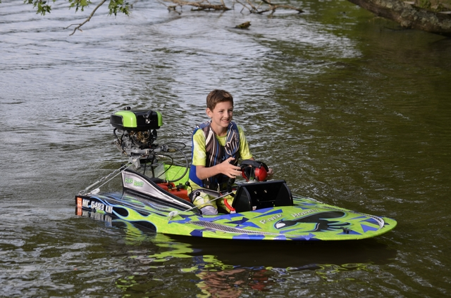 Joshua aboard his minimax hydroplane. One proud kid, as well he should be.