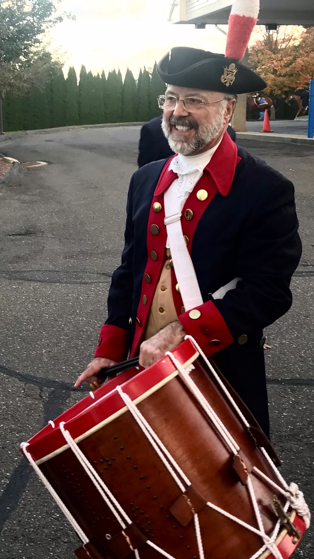 David Petro-Roy, a member of the Mattatuck Drum Band, and his repaired 1837 Eli Brown rope tension drum.