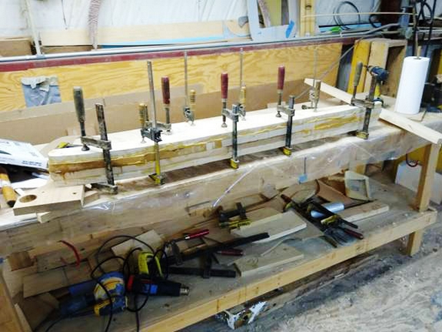 Everything is clamped together while the epoxy used in the gaff repair cures.